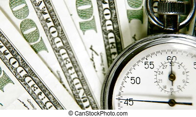 Time Is Money - A stopwatch on a background of american...