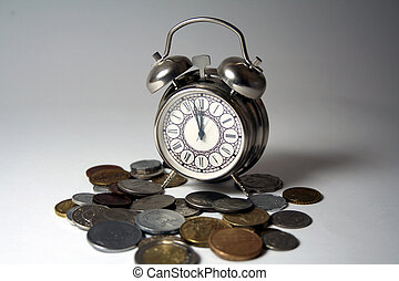 Time is money... Clock surrounded by coins