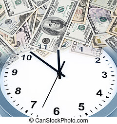 Time is money - Clock on assorted American banknotes. Time...