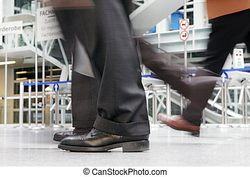 time is money - Zeit ist Geld - legs of a businessman in a...