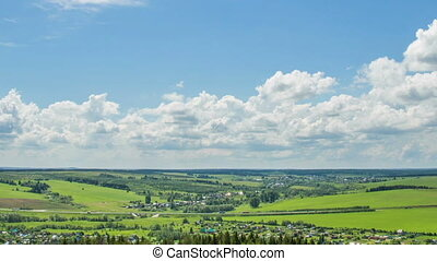 Time laps over a beautiful summer landscape, camera shift in...