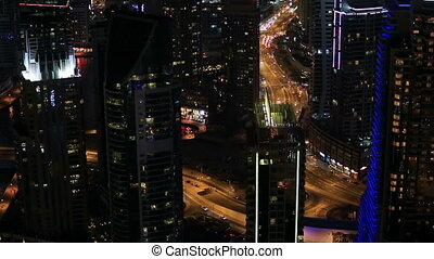 time lapse aerial view Downtown Road with Dubai Marina in United Arab Emirates at night