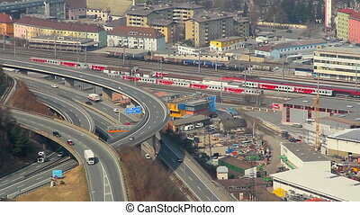 """Time lapse, aerial view of intensive traffic on flyover, railway"""