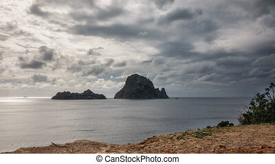 Time Lapse backlit Clouds over the mysterious island of Es Vedra
