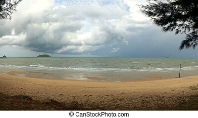 Time-lapse. Beach and storm sky over the sea