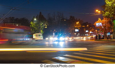 Time lapse beautiful night cityscape with motion blur cars and peoples. Moving camera
