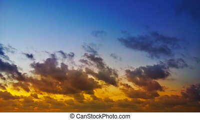 Time lapse - blue and yellow clouds