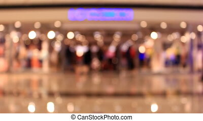 Time Lapse blurred Shopping Mall with walking people