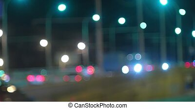 Time lapse Busy overpass defocused night traffic and line of...
