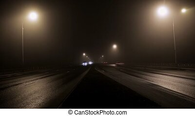 TIme lapse cars on the road in the fog
