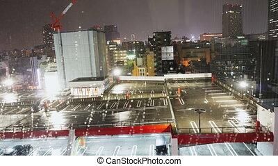 Time lapse cityscape in the rain