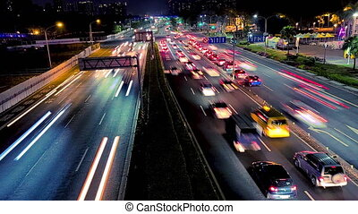 Time lapse clip  in evening with traffic of cars