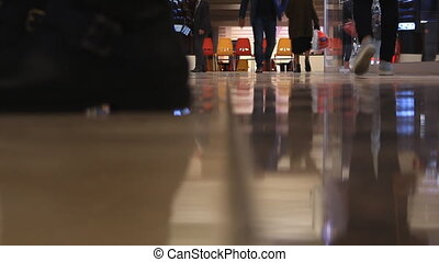 Time lapse. Close-up feet walking people in the mall