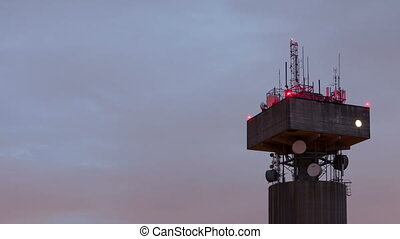 time lapse close up of a telecommunications tower with...