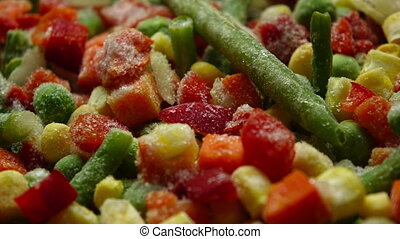Time lapse close up video: defrosting bright vegetable mix -...