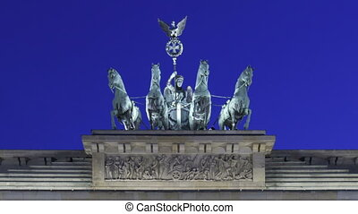 Time lapse close up of Brandenburg Gate at sunset with twilight and the Quadriga on top of the gate in Berlin