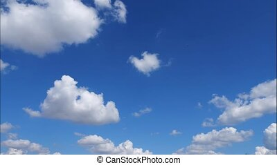 Time lapse clouds, fast rolling puffy clouds are moving,...