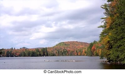 Time Lapse - Clouds Fly Over Lake Surrounded by Fall Colors of Trees in Vermont