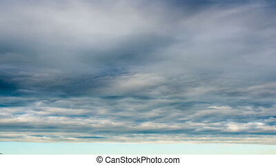 Time lapse clouds on sunset sky