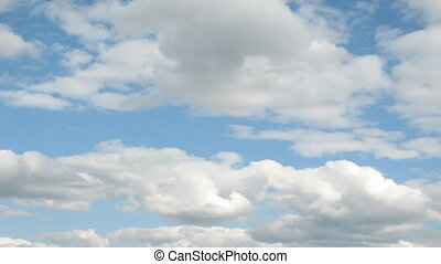 Time lapse clouds over blue sky - Time lapse clip of white...