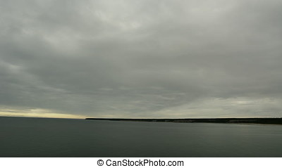 Time Lapse, Clouds rolling in over a calm Baltic sea during winter