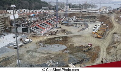 time lapse stadium construction zone with heavy equipment and workers