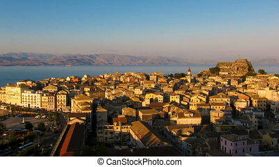 Time-lapse: aerial view of old city from New fortress before sunset, Corfu, Greece. Tripod shot, no camera move, telephoto, sunlight.