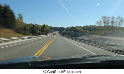 Time lapse driving over bridge.