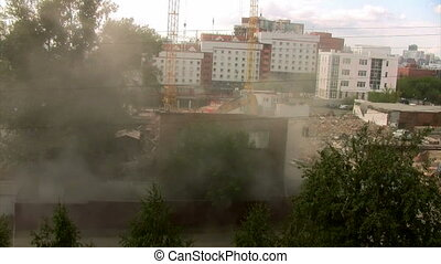 Time lapse excavator destroys brick