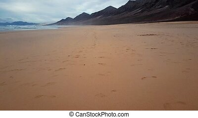 Time lapse flight over desert beach on Fuerteventura island, Spain