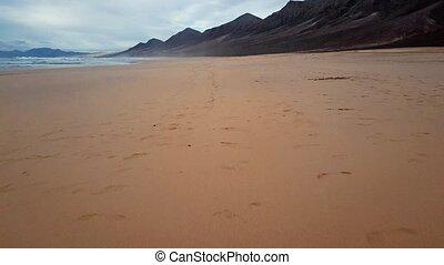 Time lapse flight over desert beach on Fuerteventura island, Spain