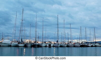 Time lapse from harbor in Palamos of Spain with many sailboats at the evening