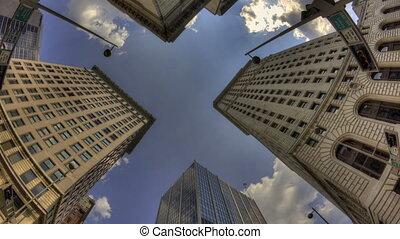 Time lapse HDR zoom in Cincinnati skyscraper with a blue sky...