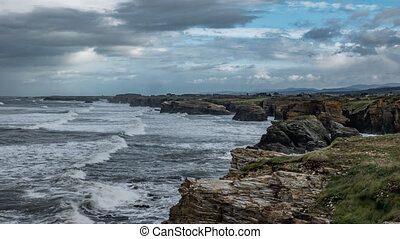 Time-lapse in cathedral beach with rugged coastline - Wide ...
