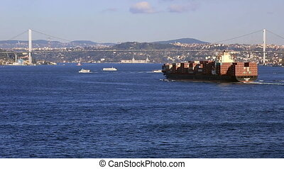 cargo ship - time lapse large cargo ship passing Bosporus...