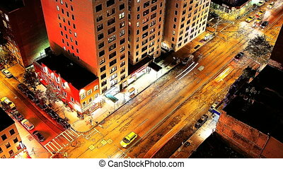 time-lapse looking down onto a new york street of fast moving traffic at night