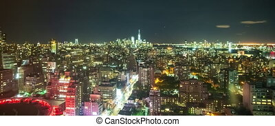 TIME LAPSE: Manhattan at Night with Airplanes Passing and City Lights Glowing