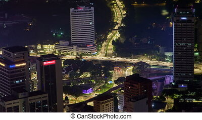 time-lapse night city skyline with traffic Kuala Lumpur. pan up