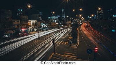 Time-lapse night megapolis, long-exposure traffic 4K