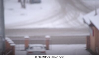 Time lapse of a blurred wintry road in a city - Time lapse...