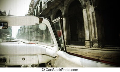 time-lapse of a havana street scene shot from a classic convertible car, cuba, filtered with an old film look