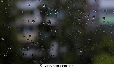 Time lapse of bad weather. Drops of water on the glass, the rain is outside the window, the background image