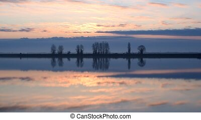 Time lapse of beautiful sunrise over lake or river