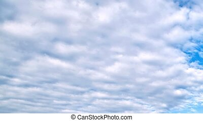 beautiful white clouds moving over blue sky