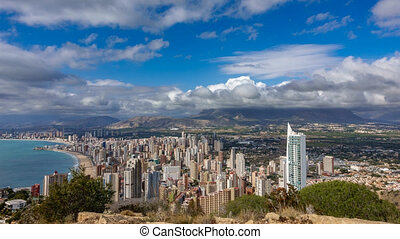 Time lapse of Benidorm with high buildings, mountains and sea