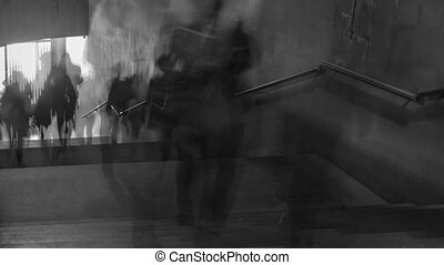 Time Lapse of black and white pictures of walking people on the stairs. Camera zoom out