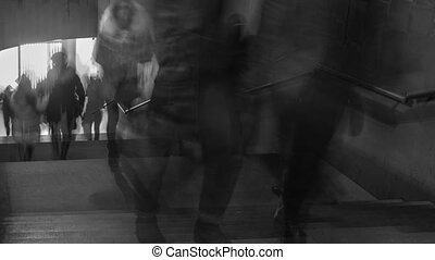 Time Lapse of black and white pictures of walking people on the stairs