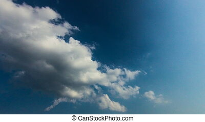 time lapse of blue sky with clouds and sun.
