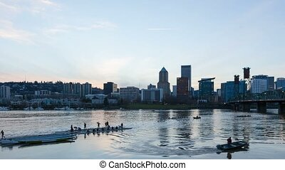 Time lapse of boat race activity and blue hour over Portland OR skyline 4k UHD