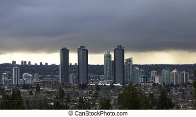 Burnaby, Vancouver, British Columbia, Canada. Time Lapse. Beautiful Panoramic Aerial View of a modern city during a stormy and rainy day. Cityscape Buildings